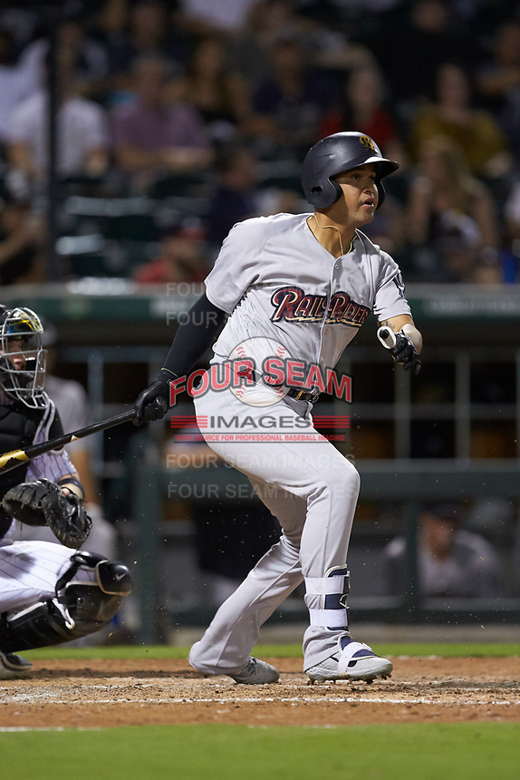 Francisco Arcia (38) of the Scranton/Wilkes-Barre RailRiders follows through on his swing against the Charlotte Knights at BB&T BallPark on August 14, 2019 in Charlotte, North Carolina. The Knights defeated the RailRiders 13-12 in ten innings. (Brian Westerholt/Four Seam Images)