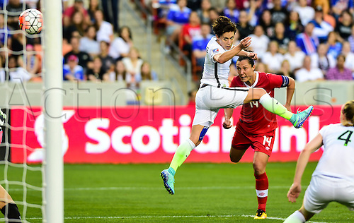 21.02.2016. Houston, TX, USA. Canada Forward Melissa Tancredi (14) and United States Defender Meghan Klingenberg (7) watch a shot go wide during the Women's Olympic qualifying soccer final between Canada and USA at BBVA Compass Stadium in Houston, Texas.