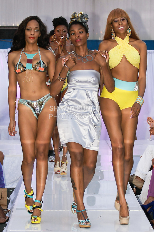 Fashion designer Eunika Simmons walks runway with models at the close of her Naked Roots Collection fashion show, during the JRG Bikini Under The Bridge 2012 fashion show on July 9, 2012.