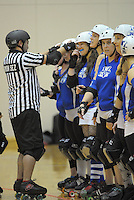 A referee inspects the Queen Bees before the Roller Derby match between the Richter City All Stars and the Victoria Roller Derby Queen Bees at TSB Bank Arena, Wellington, New Zealand on Saturday, 13 July 2013. Photo: Dave Lintott / lintottphoto.co.nz