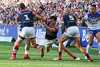 Roger Tuivasa-Sheck tackled. Sydney Roosters v Vodafone Warriors, NRL Rugby League. Allianz Stadium, Sydney, Australia. 31st March 2018. Copyright Photo: David Neilson / www.photosport.nz