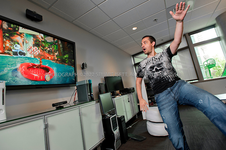 """7/11/2010--REDMOND, WA, USA..Alex Kipman, Microsoft's director of innovation for Xbox 360, plays on  Kinect for Xbox which  consists of a depth sensor that uses infrared signals to create a digital 3-D model of a player's body as it moves, a video camera that can pick up fine details such as facial expressions, and a microphone that can identify and locate individual voices. Kinect for Xbox 360, or simply Kinect was originally known by the code name Project Natal...Kinect was first announced on June 1, 2009 at E3 2009 under the code name """"Project Natal"""". Following in Microsoft's tradition of using cities as code names, """"Project Natal"""" was named after the Brazilian city of Natal as a tribute to the country by Microsoft director Alex Kipman, who incubated the project, and who originates from Brazil...©2010 Stuart Isett. All rights reserved."""