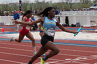 Anglerne Annelus crosses the finish line first to give Grandview the girls 4x100 relay title in 48.37 at the 2015 Kansas Relays.