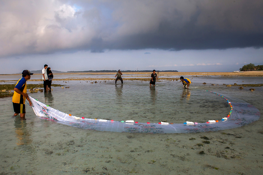 """Fishermen catch """"finger fish"""" in nets on the tiny island of Gili Air, Indonesia."""