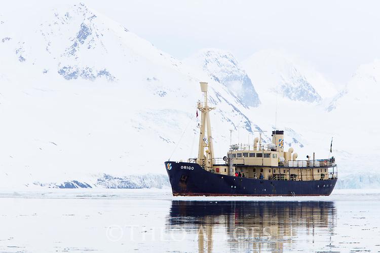 Norway, Svalbard, M/S Origo anchoring in fjord