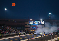 Jul 27, 2018; Sonoma, CA, USA; The full moon rises over the track as NHRA top fuel drivers do their burnouts during qualifying for the Sonoma Nationals at Sonoma Raceway. Mandatory Credit: Mark J. Rebilas-USA TODAY Sports