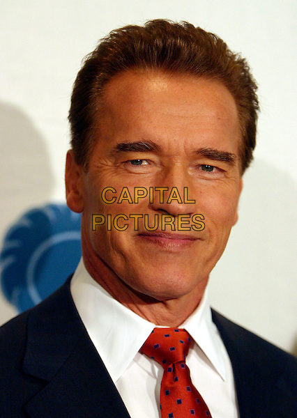 ARNOLD SCHWARZENEGGER.The California Governor's Conference on Women and Families held at the Long Beach Convention Centre, Long Beach, California, 07 December 2004..portrait headshot arnie .Ref: ADM.www.capitalpictures.com.sales@capitalpictures.com.©Zach Lipp/AdMedia/Capital Pictures .