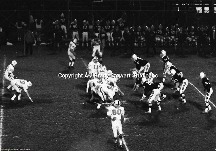 Bethel Park PA:  Offensive play with the Bethel Park offense setting up for another successful play,  Others in the  photo; Bruce Evanovich 80, Chip Huggins 32, Clark Miller 30, Dan Hannigan 64, Dennis Franks 66, Don Troup 51, Joe Barrett 75, Jim Dingeldine 73, Dan Hannigan 64, John Bender 27, Gary Biro 81, Mike Stewart 11.  The Bethel Park offense and defense played very well in the 16-0 shut out of the Upper St Clair Panthers.   The defensive unit was one of the best in Bethel Park history only allowing a little over 7 points a game.