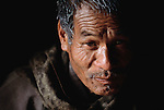 Bhu.mw2.6.xs.A portrait of Namgay, 57, family patriarch of the Material World family, in Shingkhey, Bhutan. From coverage of revisit to Material World Project family in Bhutan, 2001.