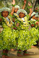 Keiki hula dancers from Halau Hula O Hokulani dancing at the Kapiolani Park Bandstand in Waikiki, Honolulu