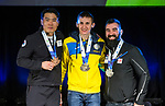 Prince George, B.-C., 16 February/2019 -  Euithyun Shin KOR (bronze), Taras Rad UKR (gold) and Collin Cameron CAN).  Collin Cameron receives his silver medal for finishing second in the men's middle distance sitting biathlon during the Medal ceremony  at the 2019 World Para Nordic skiing Championships in Prince George, B.C. Photo Bob Frid/Canadian Paralympic Committee.