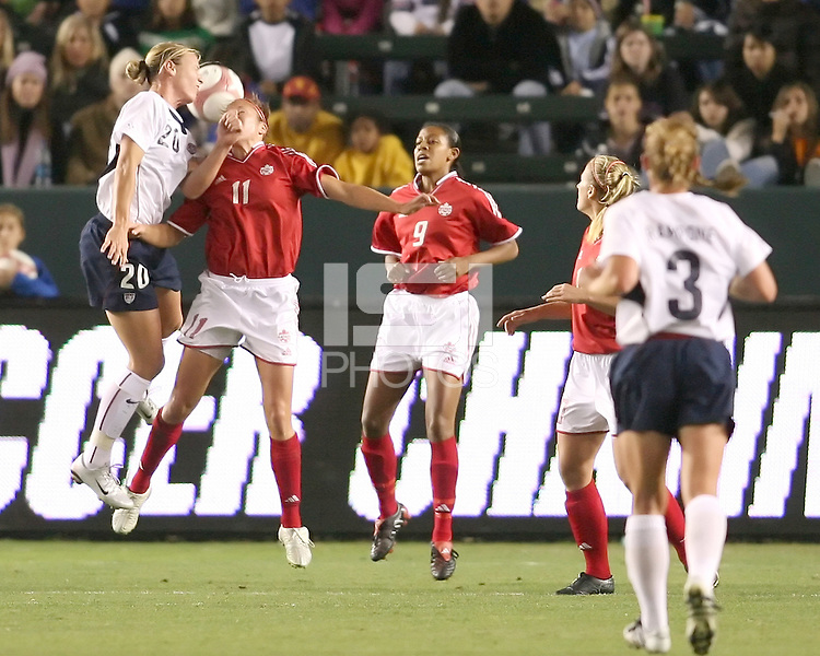 Abby Wambach and Randee Hermus tangle in the air. USA captured the 2006 Gold Cup at Home Depot stadium in Carson, California on November 26 2006 thanks to a penalty kick call by the referee with only seconds remaining in the last period of overtime. With the penalty kick score USA beat Canada 2-1.