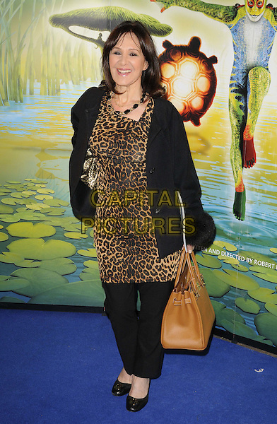 Arlene Phillips.'Cirque Du Soleil: Totem' UK Premiere, Royal Albert Hall, London, England..5th January 2012.full length black trousers jacket brown leopard print dress bag purse .CAP/CAN.©Can Nguyen/Capital Pictures.