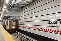 A Number One train arrives in the newly restored South Ferry subway station in New York on re-opening day Tuesday, June 27, 2017. The restored station was closed after catastrophic damage by Superstorm Sandy with an estimated 15 million gallons of water flooding the terminal which cost $545 million and was only open three years. The $340 million in repairs were finished today nearly five years after Superstorm Sandy. In the interim the Number One train used the quirky old South Ferry loop which only accommodated the first five cars of a ten car train.  (© Richard B. Levine)
