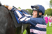 Jockey Rys Clutteruck unsaddles The Children'strust after winning The Shadwell Racing Excellence Apprentice Handicap   during Racing at Salisbury Racecourse on 5th September 2019