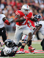 Ohio State Buckeyes running back Rod Smith (7) pulls away from Cincinnati Bearcats safety Zach Edwards (22) during the first quarter of Saturday's NCAA Division I football game at Ohio Stadium in Columbus on September 27, 2014. (Columbus Dispatch photo by Jonathan Quilter)