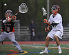 Matt Gavin #12 of Manhasset, right, takes a pass before shooting past Joseph Tortorella #10, Carey goalie, during a Nassau County varsity boys lacrosse game at Manhasset High School on Wednesday, May 4, 2016. Gavin scored five goals in Manhasset's 14-6 win.