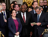 From l-r., Associate Justices Brett Kavanaugh, Elena Kagan, Clarence Thomas, and Chief Justice John Roberts arrive for services for former President George H.W. Bush is carried by joint services military honor guard into the Capitol in Washington, Monday, Dec. 3, 2018. (AP Photo/Pablo Martinez Monsivais/Pool)