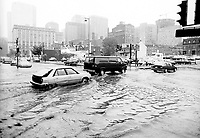 Montreal (QC) Canada- July 14, 1987 File Photo - Montreal Flood of 1987.<br /> <br /> The Montreal Flood of 1987 happened on July 14 of that year when a series of strong thunderstorms crossed the island of Montreal, Canada, between the noon hour and 2:30 p.m. Over 100 mm of rain fell during this very short period of time. The sewer systems were overwhelmed by the deluge and the city was paralyzed by the flooded roads. Autoroute 15, a sunken highway also known as the Decarie Expressway, soon filled with water trapping motorists. Some 350,000 houses lost electricity, and tens of thousands had flooded basements. Two people died, one in a submerged car and another who was electrocuted
