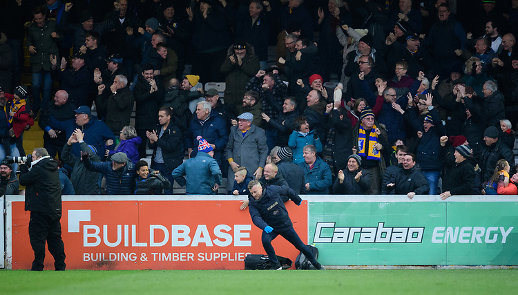 Mansfield Town fans celebrate their teams goal, scored by Jacob Mellis<br /> <br /> Photographer Chris Vaughan/CameraSport<br /> <br /> The EFL Sky Bet League Two - Lincoln City v Mansfield Town - Saturday 24th November 2018 - Sincil Bank - Lincoln<br /> <br /> World Copyright © 2018 CameraSport. All rights reserved. 43 Linden Ave. Countesthorpe. Leicester. England. LE8 5PG - Tel: +44 (0) 116 277 4147 - admin@camerasport.com - www.camerasport.com