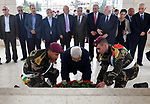 Palestinian President Mahmoud Abbas and new members of Executive Committee of Palestinian Liberation Organization lay wreath of flowers on the tomb of the late President Yasser Arafat, in the West Bank city of Ramallah on May 4, 2018. Photo by Thaer Ganaim