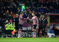 Lincoln City's Jason Shackell, right, is replaced by Lincoln City's Cian Bolger after suffering an injury in the first half<br /> <br /> Photographer Chris Vaughan/CameraSport<br /> <br /> The EFL Sky Bet League Two - Lincoln City v Yeovil Town - Friday 8th March 2019 - Sincil Bank - Lincoln<br /> <br /> World Copyright © 2019 CameraSport. All rights reserved. 43 Linden Ave. Countesthorpe. Leicester. England. LE8 5PG - Tel: +44 (0) 116 277 4147 - admin@camerasport.com - www.camerasport.com