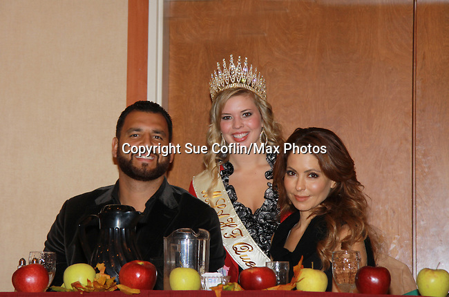 """Anthony Becht & Lisa LoCicero with Kaitlin Wagoner (Queen Pomona XXXII at sports breaksfast - General Hospital Lisa LoCiero """"Olivia Falconeri"""", Loving """"Joscelyn Roberts Brown moving onto The City, One Life To Live """"Sonia Toledo Santi"""" as the Celebrity Grand Marshall appears with Anthony Becht NFL player (Sports Celebrity Marshall) at the 32nd Annual Mountain State Apple Harvest Festival during the Weekend of October 14-16, 2011 in Martinsburg, West Virginia. Lisa and Anthony attended the Bob Elmer Rotary Sports Breakfast at the Martinsburg Holiday Inn, Martinsburg, West Virginia. (Photo by Sue Coflin/Max Photos)"""