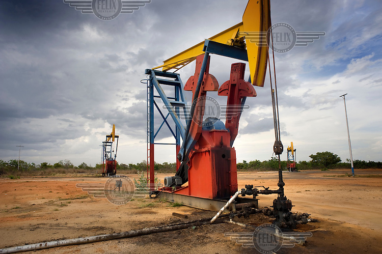 Oil derricks in Faja Orinoco between the El Tigre and Puerto Ordaz. This region contains the world's largest oil reserves.
