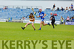Abbeydorney's Stevie Sullivan gets his shot away despite Fionan MacKessey of St Brendans bearing down on him,  in R2 of the Senior Hurling Championship in Austin Stack Park on Sunday.