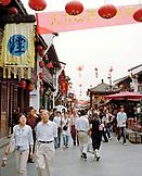 CHINA, Hangzhou, people walking in shopping district on Hefang Lu Street