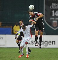 Dejan Jakovic (5) of D.C. United goes against Dimitry Imbongo (92) of the New England Revolution. The New England Revolution defeated D.C. Untied 2-1, at RFK Stadium, Saturday July 27 , 2013.