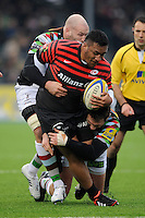 20130324 Copyright onEdition 2013©.Free for editorial use image, please credit: onEdition..Mako Vunipola of Saracens is tackled by George Robson and Tom Guest of Harlequins during the Premiership Rugby match between Saracens and Harlequins at Allianz Park on Sunday 24th March 2013 (Photo by Rob Munro)..For press contacts contact: Sam Feasey at brandRapport on M: +44 (0)7717 757114 E: SFeasey@brand-rapport.com..If you require a higher resolution image or you have any other onEdition photographic enquiries, please contact onEdition on 0845 900 2 900 or email info@onEdition.com.This image is copyright onEdition 2013©..This image has been supplied by onEdition and must be credited onEdition. The author is asserting his full Moral rights in relation to the publication of this image. Rights for onward transmission of any image or file is not granted or implied. Changing or deleting Copyright information is illegal as specified in the Copyright, Design and Patents Act 1988. If you are in any way unsure of your right to publish this image please contact onEdition on 0845 900 2 900 or email info@onEdition.com