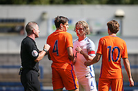 Tom Davies of England has a disagreement with Justin Hoogma of Holland during the International match between England U19 and Netherlands U19 at New Bucks Head, Telford, England on 1 September 2016. Photo by Andy Rowland.