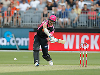 26th December 2019; Optus Stadium, Perth, Western Australia, Australia;  Big Bash League Cricket, Perth Scorchers versus Sydney Sixers; Ben Dwarshuis of the Sydney Sixers takes a big swing at the ball - Editorial Use