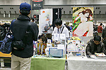 A man looks at manga illustrations at the Comic Market 91 (Comiket) event in Tokyo Big Sight on December 29, 2016, Tokyo, Japan. Manga and anime fans arrived in the early morning hours on the opening day of the 3-day long event. Held twice a year in August and December, the Comiket has been promoting manga, anime, game and cosplay culture since its establishment in 1975. (Photo by Rodrigo Reyes Marin/AFLO)