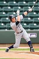 Brian Fletcher #7 of the Wilmington Blue Rocks follows through on his swing against the Winston-Salem Dash at BB&T Ballpark on June 10, 2012 in Winston-Salem, North Carolina.  The Dash defeated the Blue Rocks 2-0.  (Brian Westerholt/Four Seam Images)