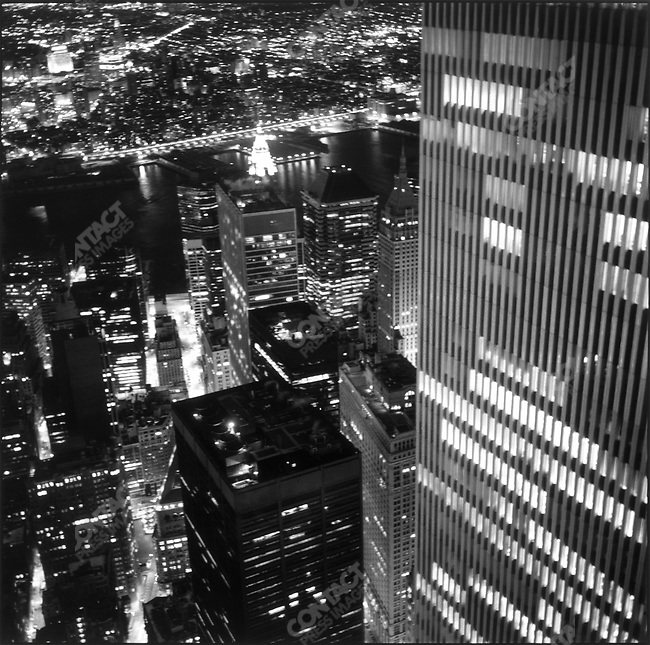 """World Trade Center's south tower seen at night from """"Best Bar in the World"""" in the north tower, New York City, New York, USA, June 2001"""