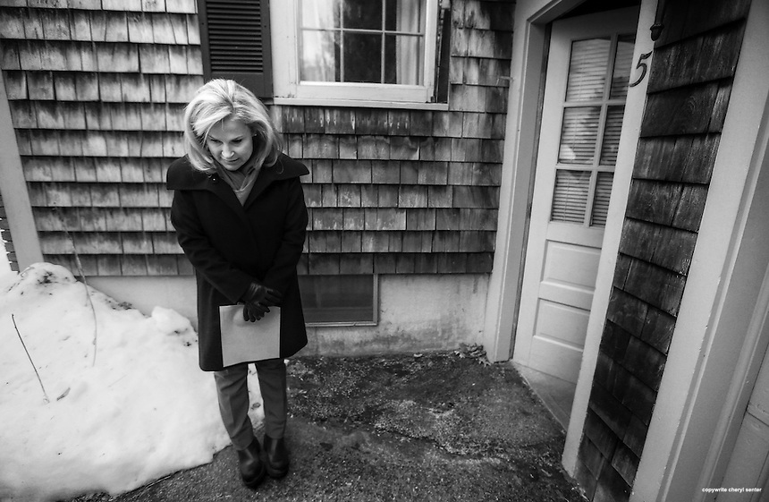 Waiting to see if the homeowner will come to the door, Heidi Cruz, wife of Republican presidential candidate Sen. Ted Cruz, R-Texas, goes door to door campaigning for her husband in Nashua, N.H. Friday, Jan. 8, 2016.  CREDIT: Cheryl Senter for The New York Times