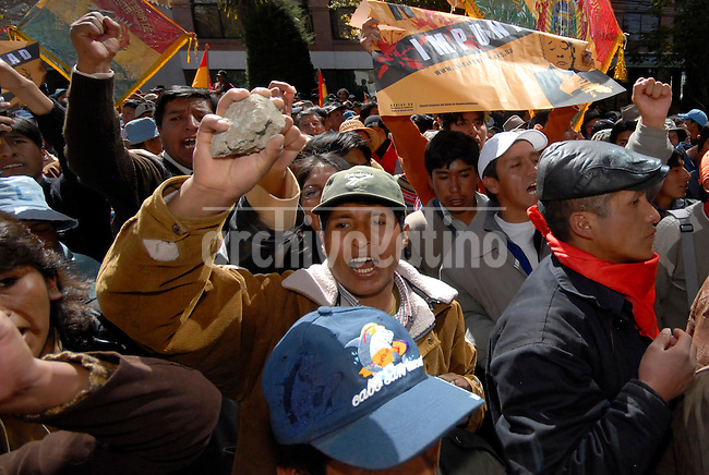 Demonstrators surround the United States embassy in La Paz June 9, 2008. Thousands of supporters of leftist Bolivian President Evo Morales tried to storm the U.S. embassy in La Paz, demanding the United States repatriate two Bolivian rightwing politicians - former President Gonzalo Sanchez de Lozada and former government minister Carlos Sanchez Berzain.