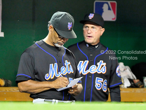 New York Mets manager Jerry Manuel (53) looks over his notes as coach Dave Jauss looks on in the eighth inning against the Washington Nationals at Nationals Park in Washington, D.C. on Tuesday, September 7, 2010.  The Mets won the game 4 - 1..Credit: Ron Sachs / CNP.(RESTRICTION: NO New York or New Jersey Newspapers or newspapers within a 75 mile radius of New York City)