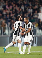 Calcio, Serie A: Torino, Juventus Stadium, 6 maggio 2017. <br /> Juventus' Gonzalo Higuain (l) celebrates with his teammate Medhi Benatia (r) after scoring during the Italian Serie A football match between Juventus and Torino at Torino's Juventus stadium, May 6, 2017.<br /> UPDATE IMAGES PRESS/Isabella Bonotto