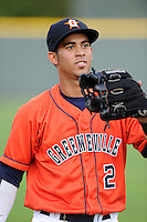 Third baseman Luis Reynoso (2) of the Greeneville Astros warms up before a game against the Bristol Pirates on Friday, July 25, 2014, at Pioneer Park in Greeneville, Tennessee. Greeneville won, 9-4. (Tom Priddy/Four Seam Images)