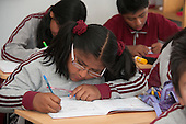 Arequipa, Peru. Hefziba, a parochial (Christian), private school for elementary and secondary school students. Student (girl, middle-school age, Peruvian) working on schoolwork in class. No MR. ID: AL-peru.