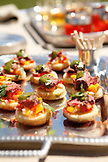 USA, Tennessee, Nashville, Iroquois Steeplechase, Open-Faced Beef Tenderloin Sandwiches with Cilantro Sauce and Mango-Red Onion Relish over Cornbread Mini Muffin Halves on tray