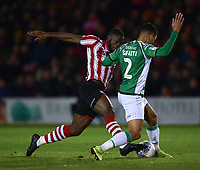 Lincoln City's John Akinde vies for possession with Yeovil Town's Adel Gafaiti<br /> <br /> Photographer Andrew Vaughan/CameraSport<br /> <br /> The EFL Sky Bet League Two - Lincoln City v Yeovil Town - Friday 8th March 2019 - Sincil Bank - Lincoln<br /> <br /> World Copyright © 2019 CameraSport. All rights reserved. 43 Linden Ave. Countesthorpe. Leicester. England. LE8 5PG - Tel: +44 (0) 116 277 4147 - admin@camerasport.com - www.camerasport.com