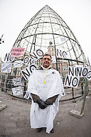 Protester in front of the Christmas Tree of Sol Square during Spanish protest against health privatization