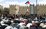 Palestinians pray on the street after they were prevented from attending prayers at Al-Aqsa mosque on Land Day , outside Damascus Gate in Jerusalem's Old City, Friday, March 30, 2012. Israeli security forces fired rubber bullets, tear gas and stun grenades to break up groups of Palestinian stone-throwers on Friday as annual Land Day rallies turned violent. Police said they had made five arrests at Damascus Gate. Land Day commemorates the killing by security forces of six Arabs in 1976 during protests against government plans to confiscate land in northern Israel's Galilee region. Photo by Mahfouz Abu Turk