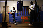 SOWETO, SOUTH AFRICA OCTOBER 25: Funsi Monta, age 17, a South African boxing champion, trains in a gym on October 25, 2006 in Soweto, Johannesburg, South Africa. He trains every day with his trainer in a hall without any proper equipment. Soweto is South Africa?s largest township and it was founded about one hundred years to make housing available for black people south west of downtown Johannesburg. The estimated population is between 2-3 million. Many key events during the Apartheid struggle unfolded here, and the most known is the student uprisings in June 1976, where thousands of students took to the streets to protest after being forced to study the Afrikaans language at school. Soweto today is a mix of old housing and newly constructed townhouses. A new hungry black middle-class is growing steadily. Many residents work in Johannesburg, but the last years many shopping malls have been built, and people are starting to spend their money in Soweto.  .(Photo by Per-Anders Pettersson/Getty Images).