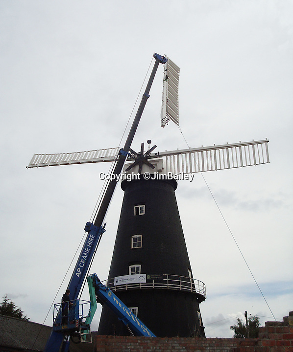 BNPS.co.uk (01202 558833)<br /> Pic: JimBailey/BNPS<br /> <br /> The sail had to be mounted in pairs to prevent the 'cap' toppling off.<br /> <br /> Octo-mill turns again...'Ferrari of windmills' is restored.<br /> <br /> Britains only eight sailed windmill is working once again after a &pound;150,000 restoration to repair its unique sails.<br /> <br /> Heckington Mill has ground wheat to make flour since 1830 but it was closed down when two of its enormous wooden sails were found to have rotted. <br /> <br /> Four years and more than 100,000 pounds were spent crafting the one-tonne, 34ft sails from the trunks of Siberian larch trees so that the historic mill near Boston, Lincs, could continue to operate.<br /> <br /> And after a nail-biting operation to crane the old sails off and replace them with the new ones, the Grade I-listed building has been brought back to life.<br /> <br /> Eight-sailed mills were at the forefront of milling technology and experts have described Heckington Mill as &quot;the Ferrari of windmills&quot;.<br /> <br /> Miller Jim Bailey, 62, hopes that with the help of the mill's new sails he can increase output to five tonnes of flour a year within the next three years.