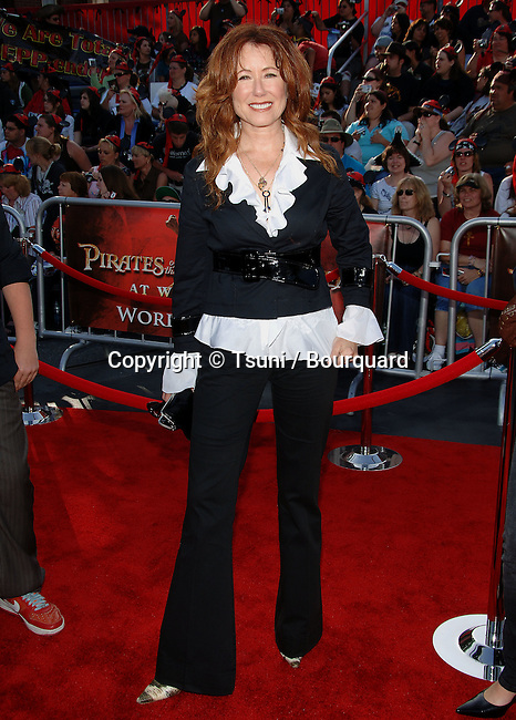 Mary McDonnell  arriving at the PIRATES of the CARIBBEAN, at Word End Premiere at Disneyland In Los Angeles. <br /> <br /> full length<br /> eye contact<br /> smile